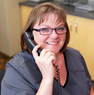 Bev Answering Phone | Point McKay Dental | Dental Appointment